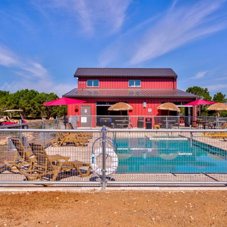 pool and clubhouse at Buddys Backyard RV Resort